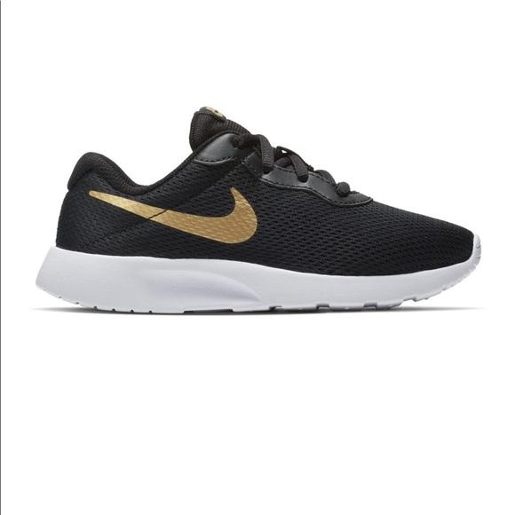 4300b2a68e9 Black gold NIKE running shoes kids 5, women's 7